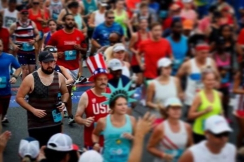 <p>Pierce (Pictured left in the American flag tank top) ran the Peachtree Road Race after spending weeks learning how to walk again.</p>