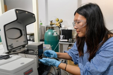 <p>Georgia Tech graduate research assistant Yu-Hsuan Liu places a sample of titanium dioxide into test equipment in the laboratory of assistant professor Marta Hatzell. (Credit: Rob Felt, Georgia Tech)</p>