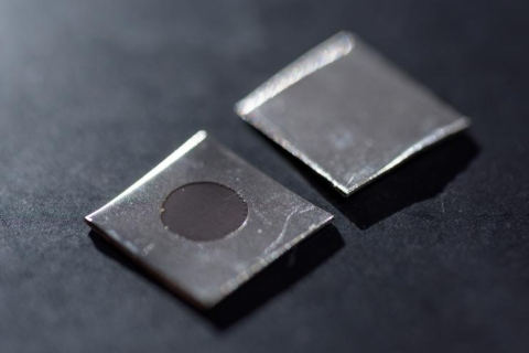 <p>Close-up image shows an untreated stainless steel sample (left), and a sample that has been electrochemically treated to create a nanotextured surface. The sample was prepared by using a potentiostat in Professor Preet Singh's laboratory at Georgia Tech. (Credit: Rob Felt, Georgia Tech)</p>