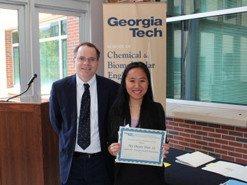 <p>ChBE School Chair David Sholl with undergrad My Duyen Tran (Grace) Le</p>